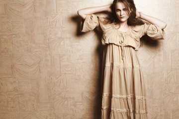 Woman in beige vintage dress
