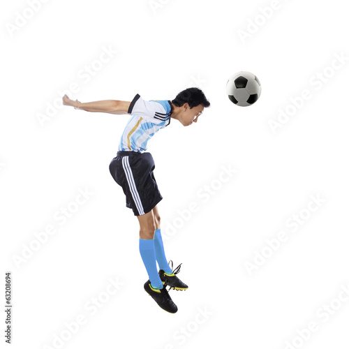 Argentine player heading ball isolated