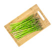 Asparagus stalks on wood cutting board