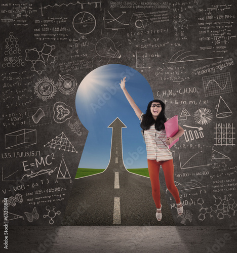 Asian female student jump on success road