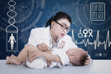 Beautiful doctor checkup baby on digital background