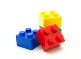 Fototapety Plastic building blocks on white background