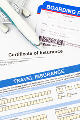 Travel insurance application form with plane model and boarding