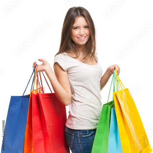Smiling woman with shopping bags isolated on white