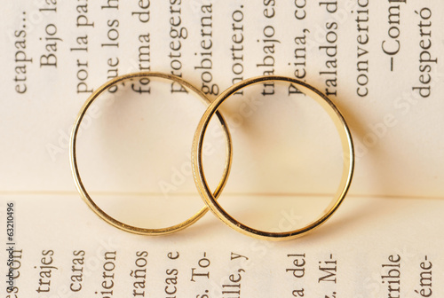 two gold rings in a book page