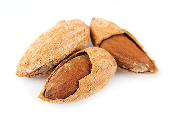Seed of almonds nuts on white