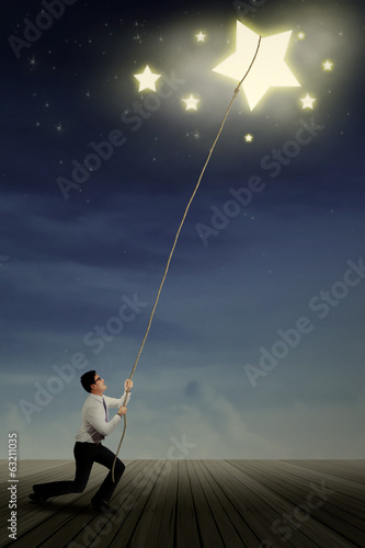 Businessman taking stars