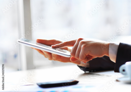 Hand touching on modern digital tablet pc