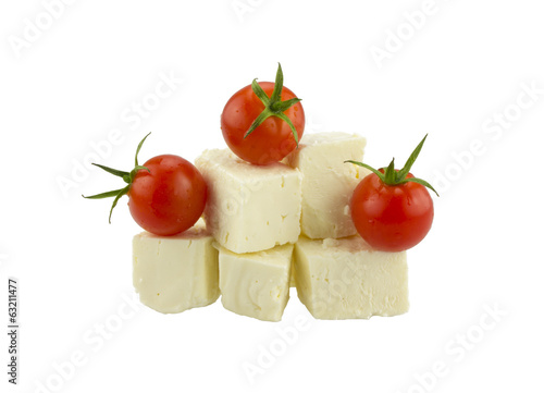 Cherry tomatoes and Greek cheese. Isolated on white