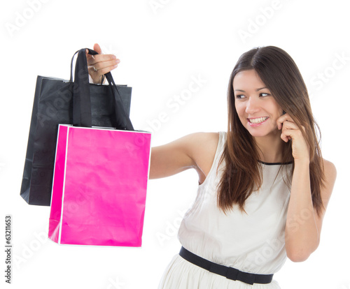 Pretty young woman with shopping bags buying presents