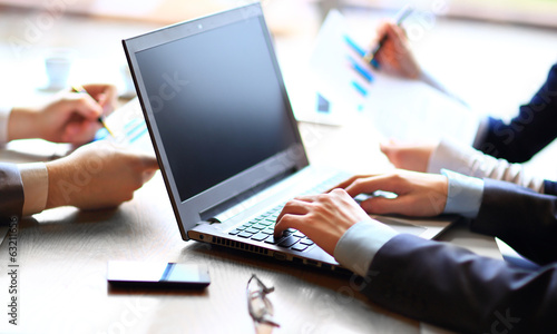 business team with files and laptop computer