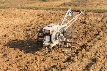 Power tiller in rice field