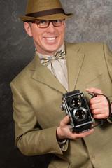 Press Photographer with retro vintage camera