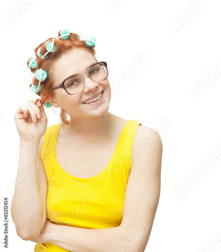 funny young woman in curlers isolated on white background