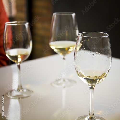 Three glasses of white wine
