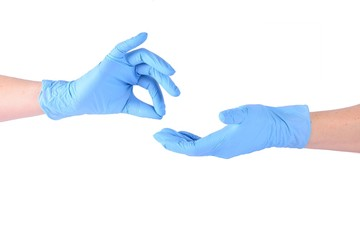 Two hands in blue gloves