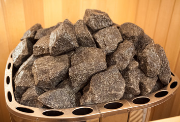 Closeup photo of granite rocks on oven at sauna