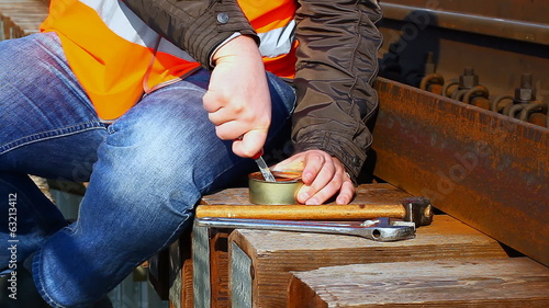 Worker try to open canned meat