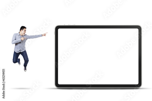 Happy man pointing at empty board
