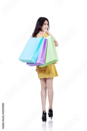 Happy shopper with shopping bags isolated