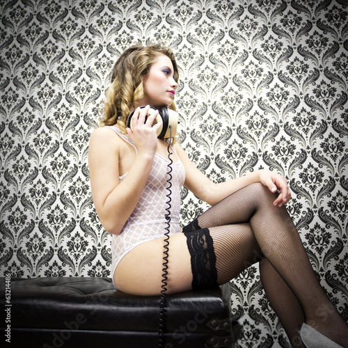 beautiful sexy disco dj woman in lingerie against vintage wallpa