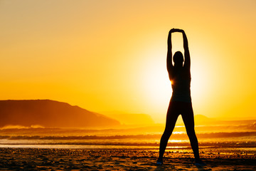 Woman exercising on beautiful sunset
