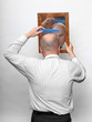 Funny picture of a man combing his hairless head.