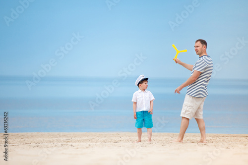 Father and son playing together on the beach