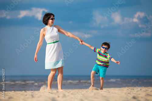 Mother and son having fun during beach vacation