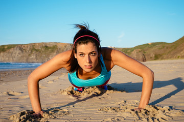Fitness woman doing push ups workout