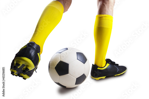 Soccer player dribbling the ball