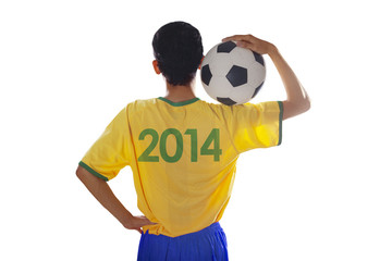 Soccer player holding ball isolated