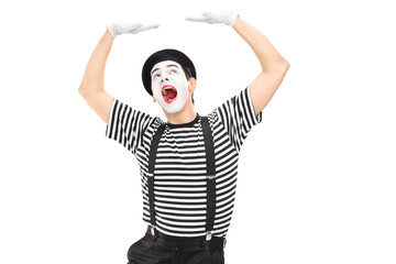 Mime artist simulate carrying something over his head