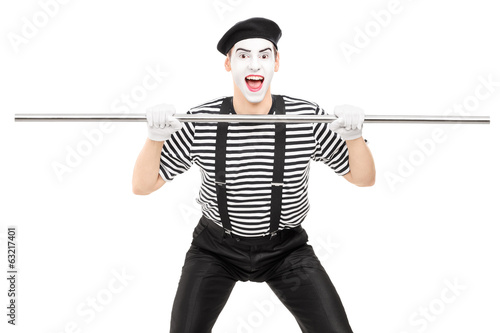Mime artist holding a big metal pipe