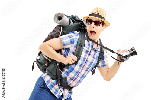 Scared hiker with backpack and camera running away
