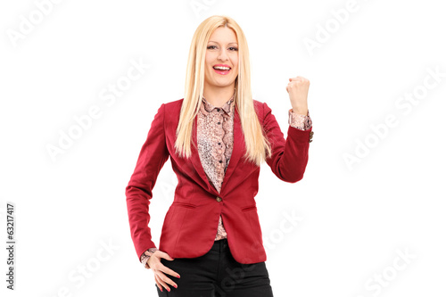 Smiling and happy young woman gesturing happiness
