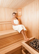 vSexy brunette woman at sauna sitting with closed eyes