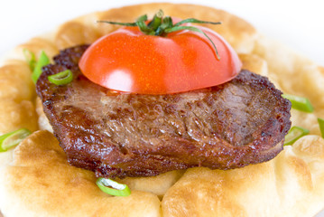 Grilled steak on a fluffy cake
