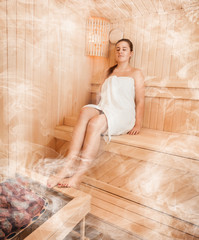 Brunette woman in towel relaxing at steamed bath