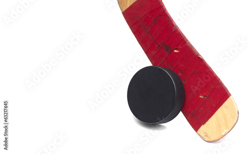 isolated hockey stick and puck