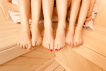 Closeup photo of female and two girls legs at sauna