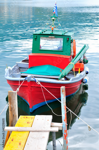 Traditional greek fishing boat painted in bright colors