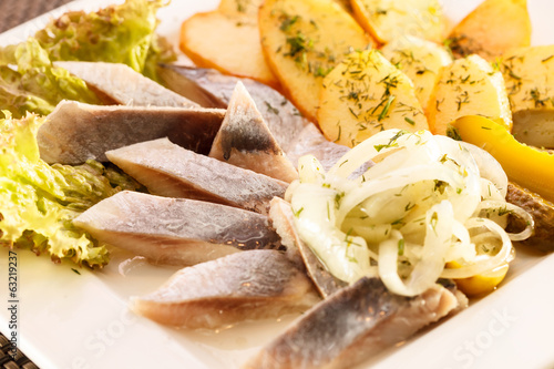 herring slice with boiled potato