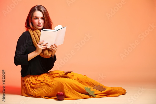 Autumn fashion girl with book orange eye-lashes