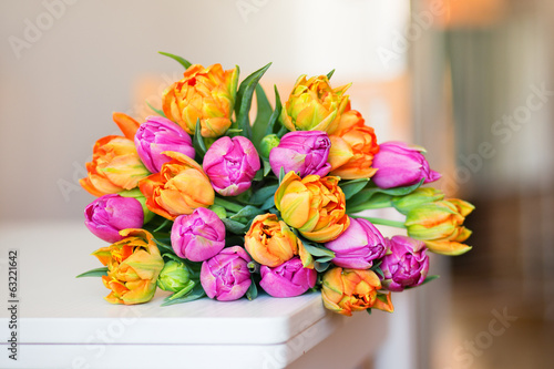 Bunch of tulips lying on the table