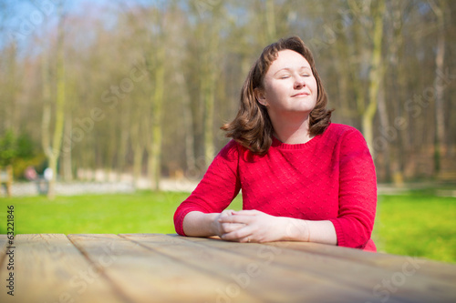 Woman enjoying warm weather in park
