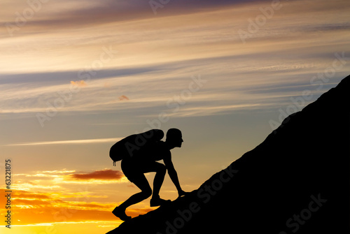 Silhouette of a man that climbs the mountain