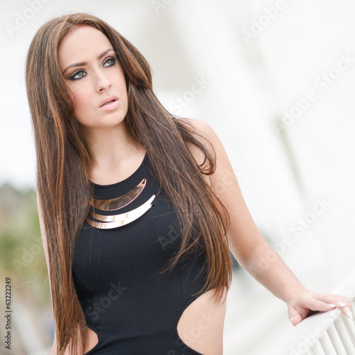 Young woman, wearing casual dress with long hair