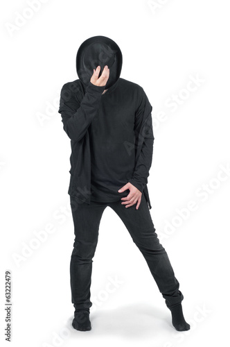 Man in black clothes dancing with his hat