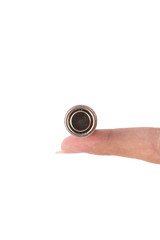 isolated of hand hold is old AA battery on white background